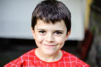portrait of 10 year old boy with spiderman suit.