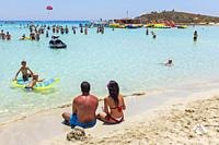 Tourists on the beach at Nissi Bay, Ayia Napa, Cyprus.
