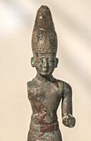 Huelva, Spain - July 02, 2018: Bronze figure of oriental deity Melqart at Archaeological Museum of Huelva, Andalusia, Spain.