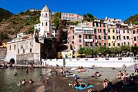 Tourists on the beach, Vernazza, Italian Riviera, Liguria, Italy.