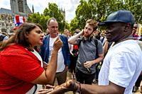 People Arguing In Parliament Square During An Anti Trump Protest, London, England.