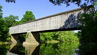 An old wooden covered bridge in summer, Pennsylvania, USA.
