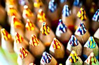 A close-up of a display of multi-colored penciled tips.
