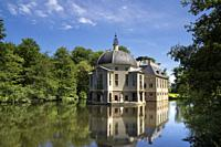 Manor house Trompenburg reflecting in its pond is an important estate near the Dutch village 's-Graveland.