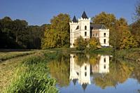 Beverweerd castle in autumn colors reflecting in de Kromme Rijn river.