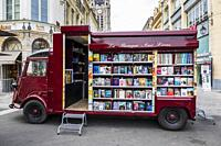 Mobile bookstore and library in the market square, Douia, Picardy, France.