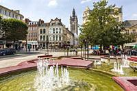 Douai town centre with the local fountains and local shops, Douai, Nord district, Picardy, France.