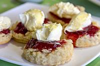 Cornish cream tea scones. Traditionally cream tea scones in Cornwall are served on a Cornish split, a sweet bread roll, with jam then cream on top.