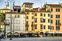 Restaurants and shops in Piazza San Giacomo in Udine, Italy.