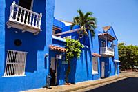 Blue Colonial house in the ancient walled city of Cartagena de Indias. UNESCO's historical patrimony of humanity. Cartagena, Colombia.