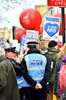 Police Liaison Officers at an NHS march, London, England, UK.