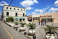Local people in front of the shops in Plaza Maceo at the historic center, Camagüey, Cuba, West Indies, Central America.