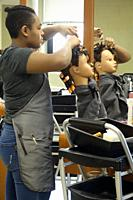 Student in Cosmetoloy Program, Practicing on Mannequin, Board of Cooperative Education Services (BOCES), Belmont, New York, USA.