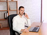 Image representing a young man doing work in the office or at home.