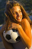 Teenage girl with handball ball outside