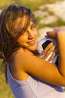 Teenage girl with ball outside