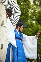 Traditional folk dancer with fan at Korean Festival, Getty Center, Los Angeles, CA.