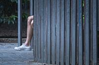 Human leg in a garden, Valencia, Spain