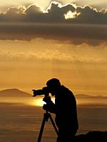 Silhouette of photographer. Sunset at from Neiste Point. Isle of Skye. Scotland