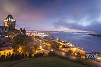 Canada, Quebec, Quebec City, elevated skyline with Chateau Frontenac Hotel, dawn, fog.