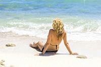 girl lying on the beach, Alcocebre, Castellon, Spain