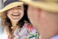 woman next to man, sunhat, vacations, happiness, toothy smile