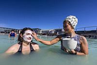 Guests enjoy the thermal waters and mud treatments of the Blue Lagoon, BlaÌ. a loÌ. nið , Iceland.