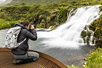 Photographer at Dynjandi, Fjallfoss, a series of waterfalls located in the Westfjords, Iceland.
