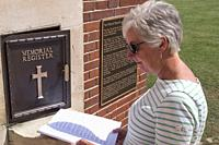 Lady looking at War Graves Register Thiepval Memorial Thiepval Albert Peronne Somme Hauts-de-France France.
