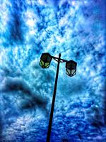 Victorian style street light isolated against deep blue sky