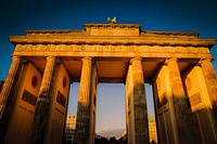 The Brandenburg Gate at sunset in Berlin Germany.