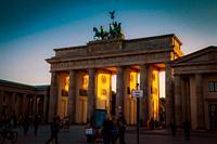 The Brandenburg Gate at sunset in Berlin Germany.