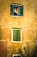 Window shutters on a Croatian home along narrow streets in the small fishing village of Baska on the island of Krk in the Adriatic.