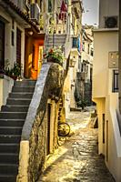 Stone steps leading up to apartments in this small Croatian village of Baska on the island of Krk in the Adriatic sea.