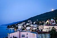 Rooftop view over the Croatian resort of Opaija Croatia as the moon rises at eventide.