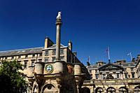 Mercat Cross with Royal Unicorn and heraldic medalions in Old Town of Edinburgh in Parliament Square on Royal Mile Scotland United Kingdom.