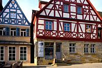 Facades of half-timbered houses at Sattlertorstrasse, hairdresser salon at ground level, historic part of Forchheim, Forchheim, Franconian Switzerland...