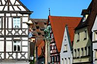View for facades at Sattlertorstrasse from the town hall square, in front on left historic timber house with statue of Virgin Mary, in front center up...