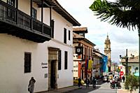 Bogota, Colombia - January 27, 2017: Looking down Calle, or translated into English, Street, 11 in La Candelaria. To the left of the image is the entr...