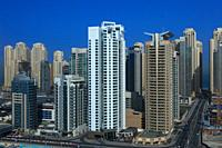 Dubai, UAE - March 19, 2009: High angle view of the Towers on Dubai Marina. Construction continues even though the rest of the work is in an economic ...