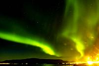 Skyline of Reykjavik at night with view on the Aurora Borealis, Iceland.