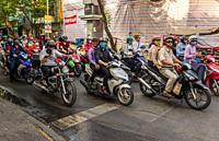 Typical Ho Chi Minh City (Saigon) street scene, crowded with motorcycles of all shapes and sizes.