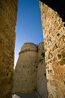 Narrow access to the city wall through Porton Nuevo (New gate). Ibiza town, Balearic Islands, Spain.