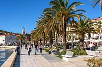 Tourists and locals enjoying Riva promenade, Split, Croatia.