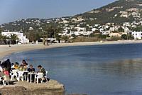 Outdoor restaurant by the sea, near Ses Salines Beach. Ibiza Town, Balearic Islands, Spain.
