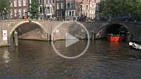 Tourist boats at the bridge of 15 bridges. Amsterdam. Netherlands