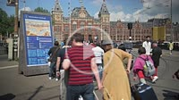 People walking in the square outside the railways Centraal Station. Amsterdam. Netherland.