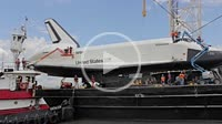 Men preparing The Space Shuttle Enterprise to be transferred to the USS Intrepid Aircraft Carrier to be put on permanent display at Sea and Space Muse...