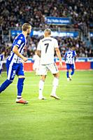 Mariano Diaz Mejia (R) of Real Madrid and Victor Laguardia (L) of Alaves in action during the La Liga match between Deportivo Alaves and Real Madrid C...