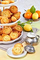 Closeup of Italian pinwheel orange pastries, typical sweets made during the carnival period from fried puff pastry flavored with orange zest and honey...